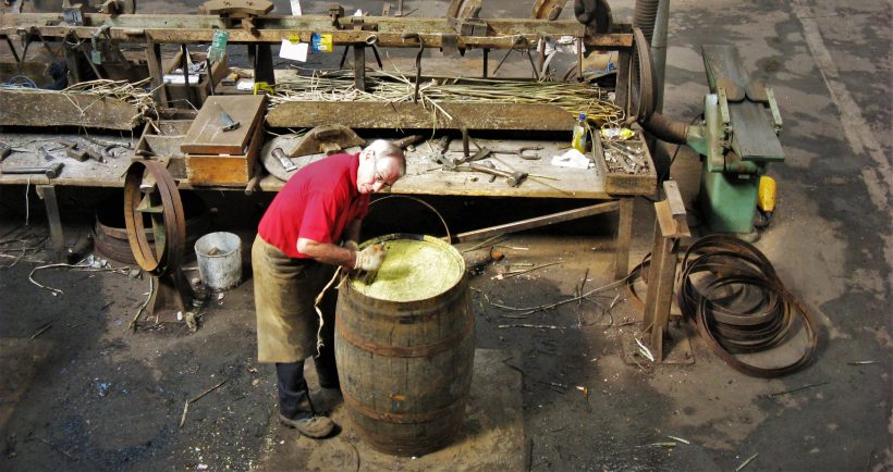 A cooper practising his craft at the Speyside Cooperage
