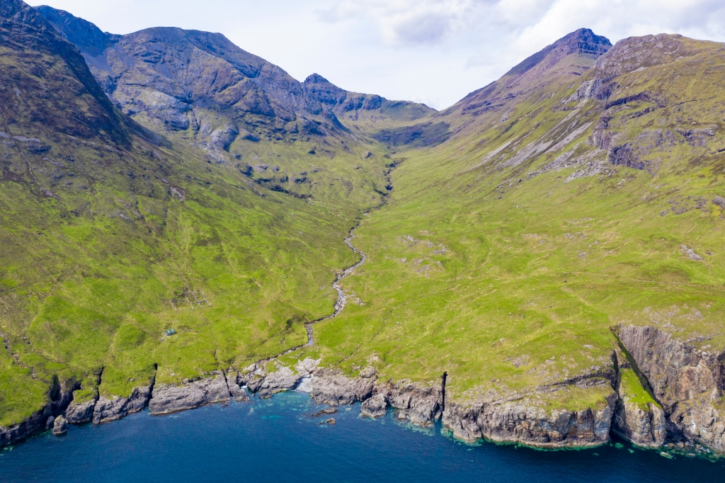 Part of the coastal hiking trail: Rùm's highest mountain - Askival - is pictured on the right, while Dibidil bothy can be seen on the bottom left. Not a bad spot to spend some time!